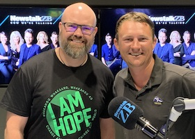 Hamish and Kyle standing in the NewstalkZB studio